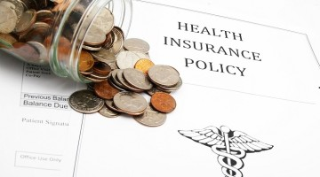healthcare policy and money from a coin jar