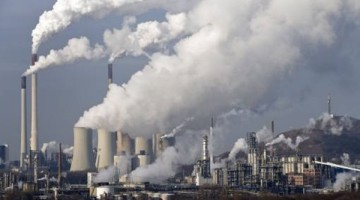 Steam and smoke is seen over the coal burning power plant in Gelsenkirchen, Germany, on Wednesday, Dec. 16, 2009. Coal power plants are among the biggest producer of CO2, that is believed to be responsible for climate change. Delegates from 193 nations at a U.N. climate talks conference in Copenhagen are deadlocked in talks on a deal to curb global warming. (AP Photo/Martin Meissner)