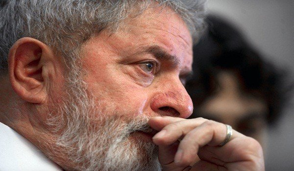 (FILE) Former Brazilian President (2003-2010) Luiz Inacio Lula Da Silva listens to a speech during a ceremony on October 25, 2011 at the Palace of Mining in Mexico City. Former Brazilian president Lula da Silva was diagnosed with larinx cancer, a hospital where the ex-leader is hospitalized said on October 29, 2011. AFP PHOTO/Yuri CORTEZ (Photo credit should read YURI CORTEZ/AFP/Getty Images)