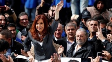 Former Argentine President Cristina Fernandez de Kirchner waves to supporters as she leaves a Justice building where she attended court to answer questions over a probe into the sale of U S  dollar futures contracts at below-market rates by the central bank during her administration  in Buenos Aires  Argentina  April 13  2016  REUTERS Marcos Brindicci