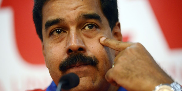 Venezuelan President Nicolas Maduro gestures as he speaks during a press conference at Venezuela's Socialist Party (PSUV) headquarters in Caracas, on October 21, 2013. AFP PHOTO/Leo RAMIREZ        (Photo credit should read LEO RAMIREZ/AFP/Getty Images)