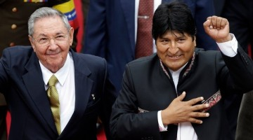Bolivian President Evo Morales arrives to the National Assembly with Cuba's Raul Castro for the inauguration of Venezuela's President-elect Nicolas Maduro in Caracas, Venezuela, Friday, April 19, 2013. Morales said Wednesday he is expelling the U.S. Agency for International Development from Bolivia for allegedly seeking to undermine his leftist government.  (AP Photo/Fernando Llano)