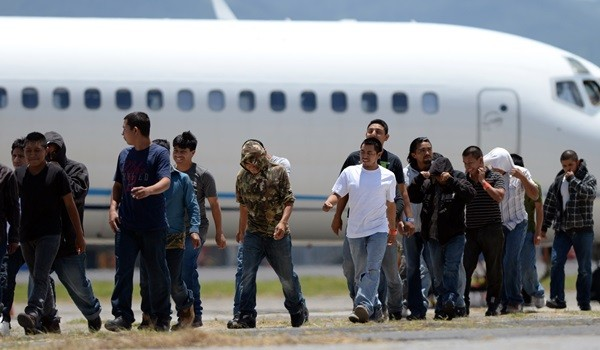 A group of 383 Guatemalans deported from the US -Phoenix, Arizona state-- walk upon arrival at the Air Force Base in Guatemala City on July 22, 2014. The United States deported at least 28,000 Guatemalans between January and June, an 11.00 percent  more expulsions than those registered during the same period last year, according to records of the General Directorate of Migration of Guatemala.    AFP PHOTO / Johan ORDONEZ        (Photo credit should read JOHAN ORDONEZ/AFP/Getty Images)