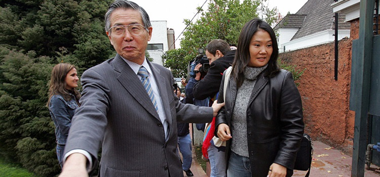 Santiago, CHILE:  Former Peruvian President (1990-2000) Alberto Fujimori (L), welcomes his daughter and congresswoman Keiko at his residence 20 May, 2006 in Santiago. Fujimori, facing trial in Peru and released from Chilean jail pending an extradition proceeding, reiterated Friday that he was innocent of the charges against him. The charges include authorizing the murder of 25 people in separate incidents in 1991 and 1992, abduction and torture of opponents, and embezzlement and corruption. Fujimori, 67, was released from a Santiago jail Thursday after posting bail of 2,800 dollars, on condition that he remain in Chile while the extradition request is reviewed. He had been jailed after arriving unexpectedly in Chile from Japan in November 2005.  AFP PHOTO MARTIN BERNETTI  (Photo credit should read MARTIN BERNETTI/AFP/Getty Images)