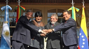 PUERTO IGUAZU, ARGENTINA:  (L to R) Presidents Nestor Kirchner from Argentina, Evo Morales from Bolivia, Luiz Inacio Lula da Silva from Brazil and Hugo Chavez from Venezuela join their hands while pose to photographers after a work meeting in Puerto Iguazu, north of Argentina, 04 May 2006. The leaders met to discuss Bolivia's move to nationalize the country's gas industry. Some 26 international energy firms, including Brazil's state giant Petrobras, Spain's Repsol YPF, Total of France, British Gas and Exxon of the United States are affected by the nationalization, which Morales promised to carry out before being elected last December. AFP PHOTO ANTONIO SCORZA  (Photo credit should read ANTONIO SCORZA/AFP/Getty Images)  Published Credit: Agence France Presse/Getty Images