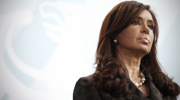 Cristina Fernandez de Kirchner, Argentina's president, listens during a news conference in Berlin, Germany, on Wednesday, Oct. 6, 2010. Argentina plans to pay back all its debt, Fernandez said. Photographer: Michele Tantussi/Bloomberg *** Local Caption *** Cristina Fernandez de Kirchner