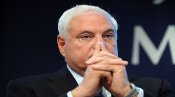(FILE) File picture taken on November 18, 2011 of Panama's President Ricardo Martinelli during a meeting at the French employers association Medef headquarters in Paris. Italian fugitive Valter Lavitola, wanted in connection with a sex and corruption scandal involving Italy's ex-premier Silvio Berlusconi, and arrested on April 16, 2012 is under investigation for having allegedly bribed members of Panama's government with suitcases stuffed with cash for construction contracts on behalf of third parties, the Corriere della Sera newspaper said.   AFP PHOTO  ERIC PIERMONT