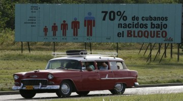 "FILE - In this Nov. 7, 2006 file photo, a car drives past a billboard that reads in Spanish; ""70 percent of Cubans have been born under the Embargo,"" in Havana, Cuba.  The United States economic embargo on Communist-run Cuba turned 50 on Feb. 7, 2012. Cuba updates its estimate of how much the embargo has cost it using a complicated - and some say flawed - calculus that takes into account years of interest, the end of the gold standard and other factors. (AP Photo/Javier Galeano, File)"