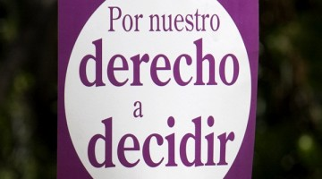 "An activist, holding a sign that reads in Spanish ""Our right to decide"", takes part in a pro-abortion protest in Mexico City, Monday, April 23, 2007."