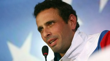 "Venezuelan opposition leader Henrique Capriles speaks during a press conference after presenting his registration as candidate for the upcoming presidential election  in Caracas, on March 11, 2013. Venezuela has entered a bitter election race to succeed Hugo Chavez, with his chosen successor Nicolas Maduro branding his challenger, Capriles, a ""fascist"" after he accused him of exploiting the late leader's death.  AFP PHOTO/Geraldo Caso"