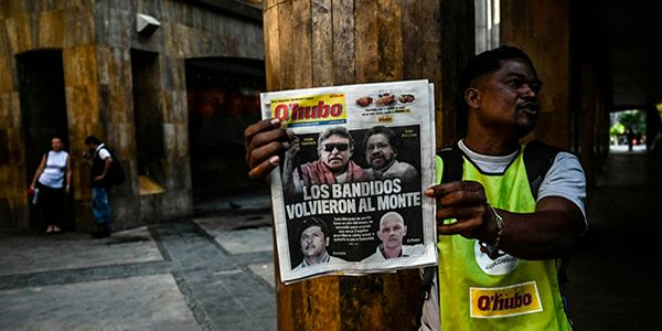 Front pages in Colombia on Aug. 30 led with the news that former FARC leaders were taking up arms again against the government. (Joaquin Sarmiento/AFP/Getty Images)